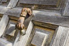 Door Detail. Rusty iron handle and peeling paint Stock Image