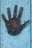Door details with hand. Grunge painted door details with rusty metal hand Royalty Free Stock Images