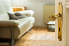 Door and door handle - blurry view in living room royalty free stock photography