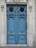 Door and Doorway. Large blue door in a stone carved doorway Stock Photos