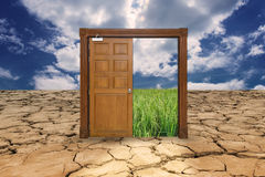 Door on drought land entrance to the rice field Royalty Free Stock Images