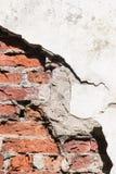 Door een gat in een muur is het zichtbare bakstenen Royalty-vrije Stock Foto