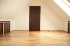 Door in empty loft room. Door in empty loft interior room stock images