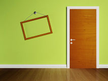 Door in the empty room and a frame Stock Photos