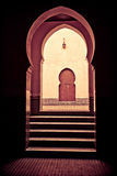 Door at the end. Puerta the background, behind a courtyard and several entries with Arab forms Royalty Free Stock Photography