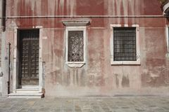 Door entrance of an ancient building. Venezia, Italy - September 08, 2015 : Door entrance of an ancient building in Venice Royalty Free Stock Photography