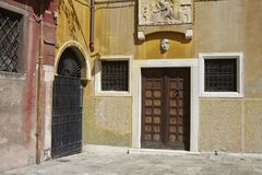 Door entrance of an ancient building. Venezia, Italy - September 08, 2015 : Door entrance of an ancient building in Venice Royalty Free Stock Images