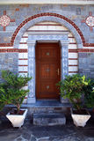 Door entrance in ornate stone house(Greece) Royalty Free Stock Image