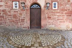 Door and entrance to the church of Herleshausen. A Door and entrance to the church of Herleshausen Stock Photography