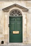 Door entrance to town house old antique architectural Stock Photography