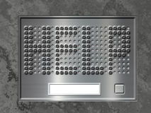 Door entry system. With push button and help embossed in speaker holes Stock Photography