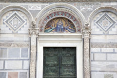 Door and Facade of Cathedral Church in Pisa Stock Photos