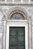 Door and Facade of Cathedral Church in Pisa Stock Image