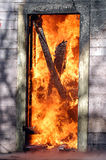 Door in flames. Flames in doorway of house Stock Photos