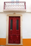 Door with a flower. Elegant carved wooden door adorned with a flower Royalty Free Stock Images