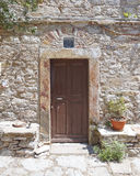 Door and flowerpot. Chios island Greece royalty free stock image