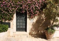 Door with flowers Stock Images