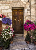 Door with flowers in Spello - HDR. Door with flowers in Spello, Umbria - HDR Royalty Free Stock Photography