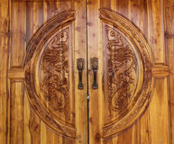 The door form wood. Dragon design in the door Royalty Free Stock Photography