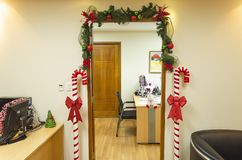 Door frame with Christmas decoration stock image