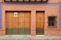 Door and garage. Brick facade with door, garage and window Stock Photos