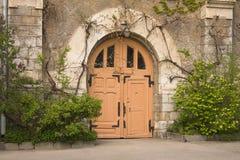 Door in a garden. Entrance door in the apartment of winery, Massandra, Crimea Stock Photo