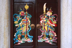 Door god. This is a very traditional kind of house gates in China, which painted the ancient generals on the two sides of the gate. They are called door gods in royalty free stock photo