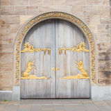 Door with gold plating Royalty Free Stock Photos