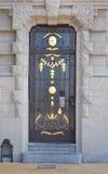 Door of a grey golden house Royalty Free Stock Photos