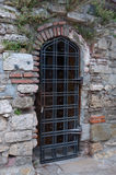 Door grille in an old brick wall. Royalty Free Stock Image