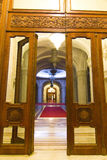 Door and hallway. A view of a palace hallway through the ornate wooden doors Royalty Free Stock Photos