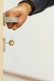 Door with an hand on the handle. Door with hand on the handle Royalty Free Stock Photography