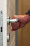Door with hand on the handle. Door with an hand on the handle Stock Image