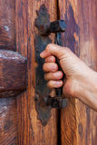 Door with a hand on handle Royalty Free Stock Photography