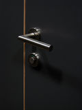 Door handle. Black door and shiny handle representing security concept Royalty Free Stock Images