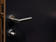 Door handle. Black door and shiny handle representing security concept Stock Photo