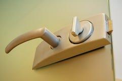 Door handle. With key from metal Stock Photo