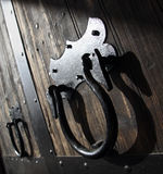 Door with handle. Door with big iron handle Stock Photography