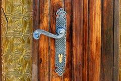 Door handle. Vintage steel door handle and broken glass Royalty Free Stock Photo