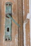 Door Handle. Old rusty door handle on a wooden door Royalty Free Stock Images