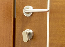 Door handle. In a wooden door royalty free stock photo