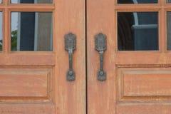 Door handle with brown wooden door Stock Photo