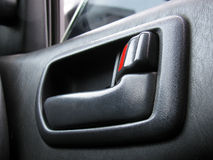 Door handle in the car Stock Images