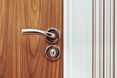 Door handle. Close up of a modern chrome door handle Royalty Free Stock Photography