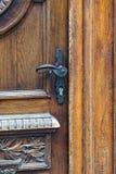 Door handle. Closed wooden door with iron handle Stock Photography