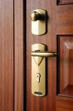 Door handle closeup. Closeup of metal handle of a wood door Royalty Free Stock Image