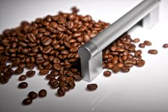 The door handle and coffee grains Stock Photo
