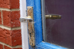 Door handle covered in spiders web Royalty Free Stock Image