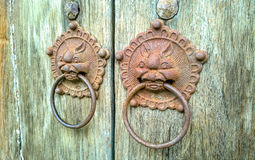 Door-handle decoration detail of old entrance door in Phuket Royalty Free Stock Photo