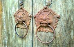 Door-handle decoration detail of old entrance door in Phuket Royalty Free Stock Photo
